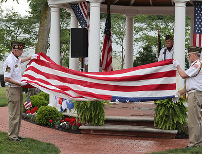 Members of the Cranberry area VFW Post 879 demonstrate and explain the flag folding procedure during the finale for the Zelienople Historical Society's Patriotic Porch Tour week celebration at the Passavant house. Seb Foltz/ Butler Eagle July 8 2021