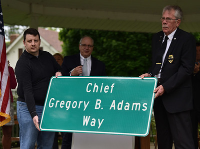 """72414  The portion of Butler Street between West Main and West Water streets was designated as """"Chief Gregory B. Adams Way"""" during a ceremony at Roebling Park, with members of the local community, governing bodies and police agencies in attendance."""
