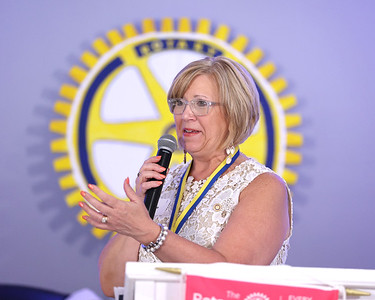 Outdoing rotary president and current county commissioner Leslie Osche MCs Friday's 100-year anniversary celebration. Seb Foltz/Butler Eagle 07/09/21