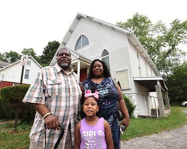 Reverand Dana Haynes, Tawnya Haynes and daughter Tamar Haynes,5, stand in front of Shiloh Baptist Church in Butler. Seb Foltz/Butler Eagle 07/09/21