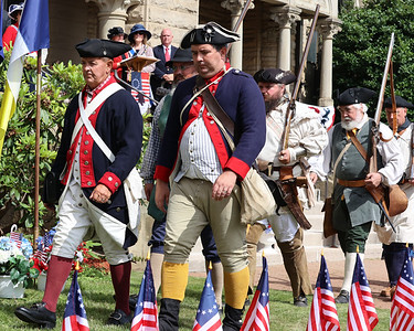 Revolutionary War reenactors from the Captain William Trent Company and German Regiment march for the unveiling of the patriots marker during Saturday's Daughters of the American Revolution memorial dedication ceremony at the Butler County Courthouse. Seb Foltz/Butler Eagle 07/10/21