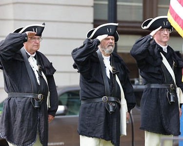 Reenactors from the Sons of the American Revolution Combined Pittsburgh & General Anthony Wayne Chapter Colorguard salute during presentation of colors at Saturday's marker dedication ceremony at the Butler County Courthouse. Seb Foltz/Butler Eagle 07/10/21