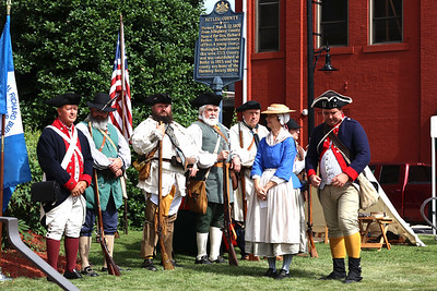 Revolutionary War reenactors from the Captain William Trent Company and German Regiment stand during the unveiling of the patriots marker during Saturday's Daughters of the American Revolution memorial dedication ceremony at the Butler County Courthouse. Seb Foltz/Butler Eagle 07/10/21
