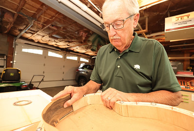 Custom guitar maker Gary Neyman explains the process of gluing together pieces of a car. Seb Foltz/Butler Eagle 07/07/21