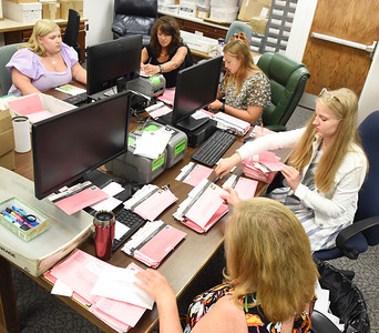 Administrative clerks from the Butler Treasurers office, from left, Samantha Thoma, Tricia McGonigle, Eliza Drohan, Montana Geibel and Cheryl Gallagher, process antlerless deer applications Monday morning. Harold Aughton/Butler Eagle