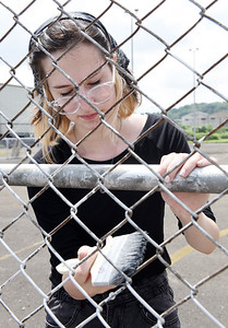 Emylia Bowser was one of about a dozen youth from Midland, Michigan volunteering their time with Fishbone Ministries this week to work on a number of community projects. Harold Aughton/Butler Eagle.