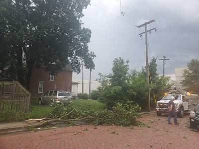 EDDIE TRIZZINO/BUTLER EAGLE  West Penn Power responds to a tree and lines down on Beckert Avenue in Butler Tuesday at around 3:40 p.m.