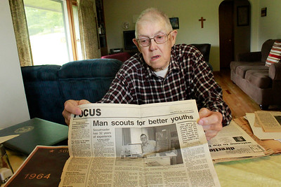 Former scoutmaster Carl Miller, 89, was featured in a Butler Eagle profile in 1998, a copy of which sits among his detailed records of the history of Lancaster Township Boy Scout Troop 360. PHOTO: Julia Maruca