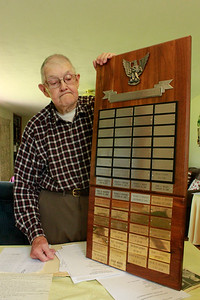 Over 60 boys have achieved their Eagle Scout rank through Troop 360, and have their names engraved on a plaque, which former scoutmaster Carl Miller has kept in his home. PHOTO: Julia Maruca