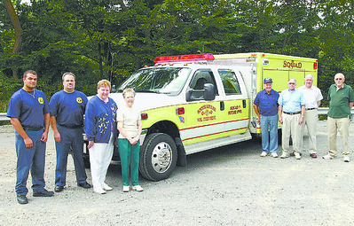 Officials stand next to the new South Butler emergency vehicle. They are, from left, Mike Schmidt, vice president of South Butler Fire Department; Brian Mazzanti, South Butler fire chief; Marylou Davis, ladies' auxiliary president;Joan Fend, auxiliary vice president; and repre- senting the Butler Township Water and Sewage Authority are Richard Dumbaugh Sr., Ernie Oeserling, John Mall, and Archie Mann. RICK KROSEL/SPECIAL TO THE EAGLE