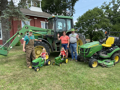 From left, interim pastor Dave Fox, Caleb Kennedy, Bryson Kennedy and their grandparents Sandy and Dave Cox gave a preview of this Sunday's Drive Your Tractor to Church service at Mt. Nebo Presbyterian Church.