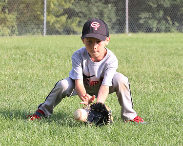Corbin Undercuffler,8, fields a grounder during Center Township rec allstar team practice Tuesday. Seb Foltz/Butler Eagle 07/14/21