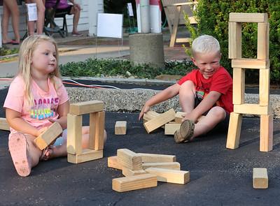 Maverick Osterling, 4, (right) and Kennedy Birckbichler, 4, play with blocks at Thursday's Mingle on Main in Saxonburg. Seb Foltz/Butler Eagle 07/15/21