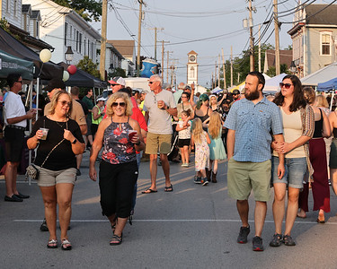 Locals and visitors walk down Main St in Saxonburg during the town's monthly Mingle on Main event Thursday. Seb Foltz/Butler Eagle 07/15/21