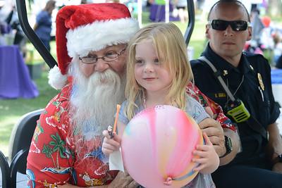 Hadley Brickett, 4, meets Santa as part of Santa's Summer Visit sponsored by Graham & Sons, Inc. at the Cranberry Community Days Festival on Saturday. Photo: Julia Maruca