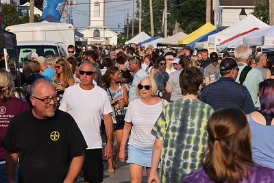 Visitors and locals walk Main Street in Saxonburg during the town's Mingle on Main Thursday. Seb Foltz/Butler Eagle 07/15/21