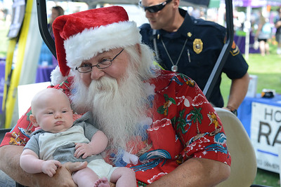 Rhett Brickett, 3 months old, meets Santa as part of Santa's Summer Visit sponsored by Graham & Sons, Inc. at the Cranberry Community Days Festival on Saturday. Photo: Julia Maruca