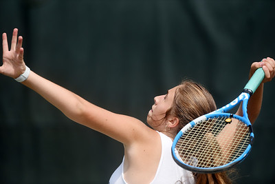 Lizzie Swift competed in the Junior Inter-Club Mixed Doubles Team Championship match at the Butler Country Club Thursday morning. Harold Aughton/Butler Eagle.