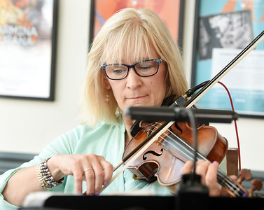 The Butler County Symphony Orchestra hosted guitarist Gary Kleeman and violinist Cristie Kecskemethy (pictured) of the Cloud Chamber at Noon on Friday. About a dozen people gatherd in Diamond Park for the lunctime performance. Harold Aughton/Butler Eagle