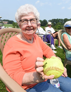 Residents of Concordia Lutheran Ministries were treated to a softball pitching exhibition by rising seniors Gabriella Aughton and catcher Alexia Brown Monday afternoon. During the exhibition, Aughton, a pitcher and Boston College commit, showed resident Jean Ohl, 86, how to grip a three knuckle change up. Harold Aughton/Butler Eagle