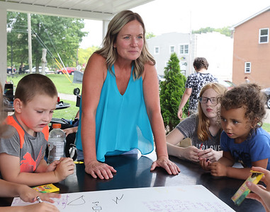 Butler Area School District teacher Lee Dittman works with children at Rotary Park Tuesday. Seb Foltz/Butler Eagle 07/20/21