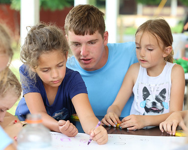 Student volunteer Cole Slezak, 17, works with Layla, 9, (left) and Gracie, 6, on a shapes and numbers lesson with Butler Area School District teacher Lee Dittman (not pictured) at Rotary Park. Seb Foltz/Butler Eagle 07/20/21