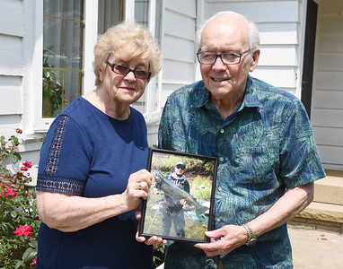 Joan and Floyd Osborne of Butlerr hold a picture of their grandson John Ficca. The Osbornes' have donated money to Moraine State Park to crate a park with a fishing pier and picnic talbes in John's memory.