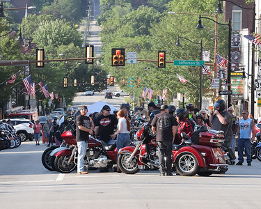 Motorcycle get ready for Thursday's parade down Main St. to kick off this weekend's Butler Bikes & BBQ at the Butler Farm Show. This is the event's inaugural year. Seb Foltz/Butler Eagle 07/22/21