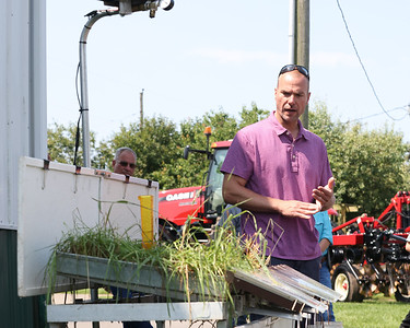 Natural Resources Conservation Service representative Andy Gaver explains no till cover crop planting benefits with a demonstration on a rainfall simulator showing how water runoff can better managed to maintain soil nutrients. Farmers from around the region spent Thursday at Thiele Dairy Farm learning about no till farming techniques through a field day with the Pennsylvania No Till Alliance. Seb Foltz/Butler Eagle 07/23/21