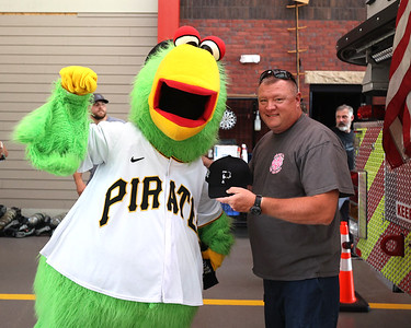 Former Adams Township fire chief Bill Hays poses for a photo with the Pirate Parrot Tuesday. Seb Foltz/Butler Eagle 07/27/21