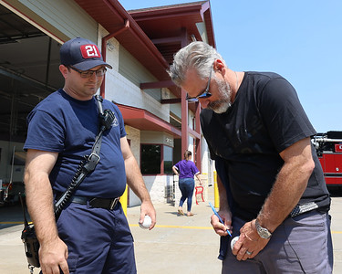 Pirates manager Derek Shelton signs an autograph for Cranberry Township fireman Jonathan Hult Tuesday, part of a meet-and-greet tour with area first responders. Seb Foltz/Butler Eagle 07/27/21