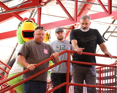 Adams fireman and former chief Bill Hays (left) gives Pirates manager Derek Shelton (right), pitcher David Bednar and the Pirate Parrot a toure of the Adams Township fire department Tuesday. Seb Foltz/Butler Eagle 07/27/21