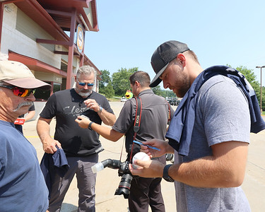 Pirate pitcher David Bednar signs a baseball for Cranberry Township firefighter Tom Klingensmith Tuesday, part of a meet-and-greet tour with area first responders. Seb Foltz/Butler Eagle 07/27/21
