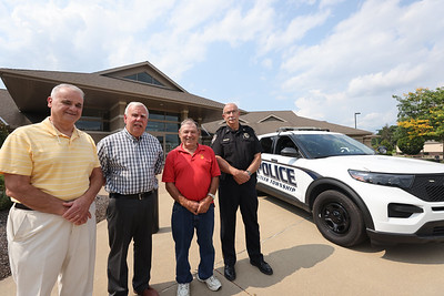 Organizers of Butler Townships community Night Out, commissioners Fred Vero, Dave Zarnick, Sam Zurzolo and police chief John Hays. Seb Foltz/Butler Eagle07/28/21