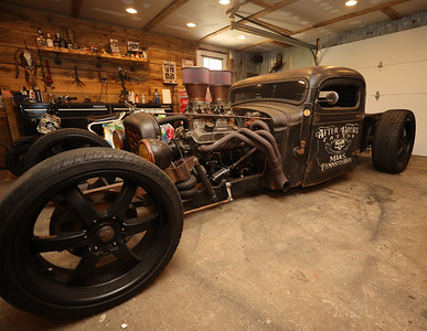 """One of After Hours Tatoo Studio and Social Club Barbershop co-owner John Podolak's """"ratrod' custom cars that will be among those featured at this weekend's Mars Rumble car show. Podolak and his shops host the event. Seb Foltz/Butler Eagle 07/28/21"""