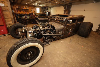 """Two of After Hours Tatoo Studio and Social Club Barbershop co-owner John Podolak's """"ratrod' custom cars that will be among those featured at this weekend's Mars Rumble car show. Podolak and his shops host the event. Seb Foltz/Butler Eagle 07/28/21"""