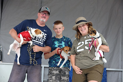 Zelienople Horse Trading Days best-in-show dog show winners: Mark Mangel with Loki, Josh Reinhardt with Gertie, and Lisa Reinhardt with Maggie. Seb Foltz/Butler Eagle 07/17/21