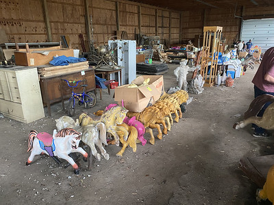 Shoppers browsed among carousel horses, amusement park memorabilia, mirrors and lighting fixtures at a liquidation sale Saturday at 360 Pittsburgh Road. ERIC FREEHLING/BUTLER EAGLE