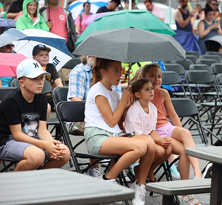 Rain didn't slowdown the enthusiasm at ShuBrew's Hot Dog Eating competition during Zelienople Horse Trading Days Saturday. Seb Foltz/Butler Eagle 07/17/21