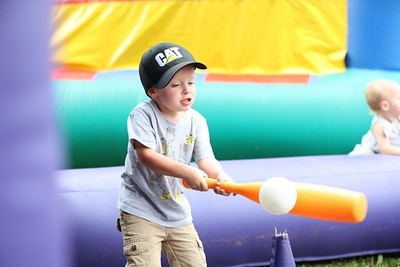 J.D. Fabyanic, 3, takes a swing at an air-powered tee-ball game ball during Zelienople Horse Trading Days Saturday. Seb Foltz/Butler Eagle 07/17/21