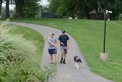 Nick (14) and Micahel Rushe (17) walk their dog, Lola, in the park at Adams Township Community Park every day. Photo: Julia Maruca