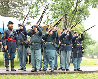Members of the 63rd PA Volunteer Infantry Civil War re-enactors fire a 21 gun salute along with the Butler veterans honor guard(not pictured) during a ceremony Saturday unveiling the new head stone for Civil War veteran and Butler resident Lt. Andrew Williams at North Side Cemetery. Seb Foltz/Butler Eagle 05/29/21