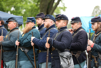 Members of the 63rd PA Volunteer Infantry Civil War re-enactors stand at attention during a ceremony Saturday unveiling the new head stone for Civil War veteran and Butler resident Lt. Andrew Williams at North Side Cemetery. Seb Foltz/Butler Eagle 05/29/21