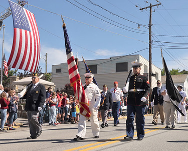 Ron Huff(center) and members of American Legion Post 642 lead the Memorial Day Parade down Main St. in Chicora Monday. Seb Foltz/Butler Eagle 05/31/21