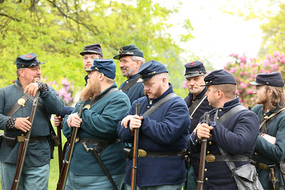 Members of the 63rd PA Volunteer Infantry Civil War re-enactors stand at eas prior to a ceremony Saturday unveiling the new head stone for Civil War veteran and Butler resident Lt. Andrew Williams at North Side Cemetery. Seb Foltz/Butler Eagle 05/29/21
