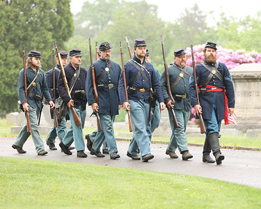 Members of the 63rd PA Volunteer Infantry Civil War re-enactors march during a ceremony Saturday honoring Civil War veteran and Butler resident Lt. Andrew Williams at North Side Cemetery. Seb Foltz/Butler Eagle 05/29/21