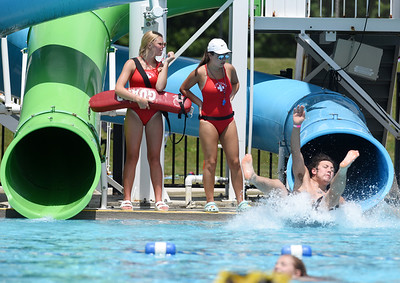 Harold Aughton/Butler Eagle: Lifeguards Brooke Tenney,15, and Emily Vajda, 16, keep a watchful eye on swimmers sliding down the water slides during the opening day at Alameda Pool, Wednesday, July 1, 2020.
