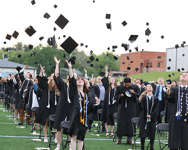 Students throw their caps in the air at Seneca Valley Graduation Tuesday. Seb Foltz/Butler Eagle 06/01/21