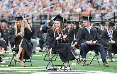 Sarah McKinley center aplauds a speech during Seneca Valley Graduation Tuesday night. Seb Foltz/Butler Eagle 06/01/21