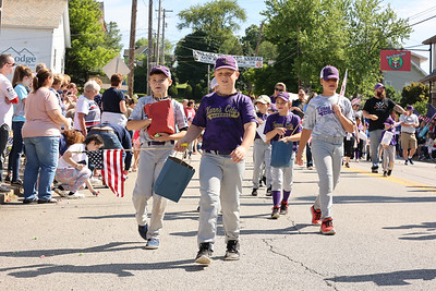 Members of Karns City's UAA baseball league march in Chicora's Memorial Day Parade Monday. Seb Foltz/Butler Eagle 2021